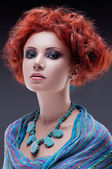 Redhead woman with turquoise necklace — Stock Photo