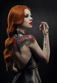 : Posh redhead woman in black dress — Стоковое фото