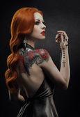: Posh redhead woman in black dress — Stockfoto