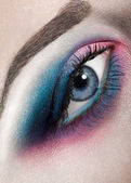 Macro beauty shot of woman eye with creative makeup — Photo