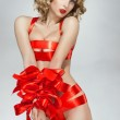 Sexy woman bound with red gift ribbon — Stock Photo #43944579