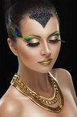 Woman with golden makeup — Stockfoto