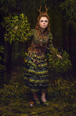 Forest girl with antlers — Stock fotografie