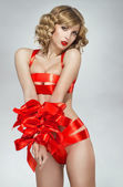 Sexy woman bound with red gift ribbon — Foto Stock