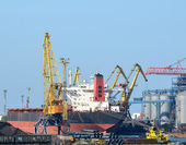 Cargo port, vessel unloading close up — Stock Photo