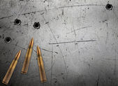 Metal plate with bullet holes — Stock Photo