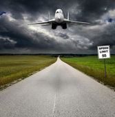 Fighter jet over the road — Stock Photo