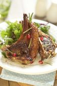 Fried lamb with pomegranate and salad — Stock Photo