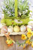 Easter basket with eggs, flowers and Easter bunny — Stock Photo