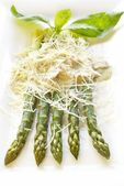 Asparagus with mushroom sauce and cheese — Stock Photo
