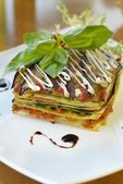 Vegetarian lasagna with vegetables, tomato and pesto sauces — Stock Photo