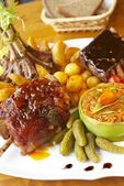 Assorted meat with vegetables garnish — Stock Photo