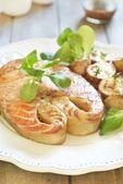 Baked salmon with potato and corn salad — Stock Photo