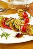 Grilled vegetables and potato fritters — Stock Photo