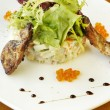 Traditional Russian salad with grilled quail and red caviar — Stock Photo #24987545