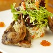 Traditional Russian salad with grilled quail and red caviar — Stock Photo #24987567