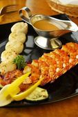 Grilled seafood on wooden sticks — Stock Photo