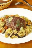 Filet mignon with couscous and vegetables — Stock Photo