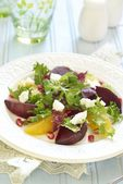 Beetroot and orange salad with cheese and pomegranate — Stock Photo