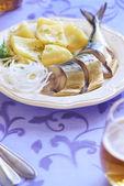 Smoked mackerel with potatoes and onions — Stock Photo