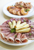 Two starter platters with smoked ham, cheese and shrimps — Stock Photo