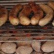 Closeup of Sausages roasting on garden grill — Stock Video #12606142