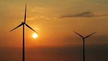 Sunset over wind turbines — Stock Video