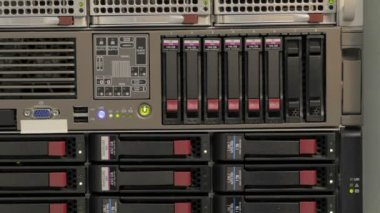 Blinking LEDs of server stack with hard drives in a datacenter — Stock Video