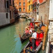 16. Jul 2012 - Gondolier with tourists at canal in Venice, Italy - Stock Photo
