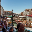 Stock Photo: 16. Jul 2012 - Large crowds of peoples under bridge Rialto Bridge in Ve