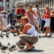 16. Jul 2012 - with pigeons in San Marco Plaza 3 in Venice, Italy - Stock Photo
