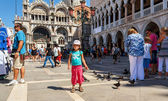 16. Jul 2012 - Small girl with pigeons in St Marco Square, in front of Doge — Stok fotoğraf