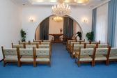 Small ruralwedding ceremony room with chandelier — Stock Photo