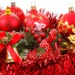 Red christmas balls and decorations on white — Stock Photo
