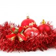 Red christmas balls and decorations on white — Stock Photo #15363623