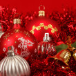 Red christmas balls and decorations on red — Stock Photo
