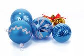 Blue christmas balls and small golden bells — Stock Photo