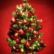 Stock Photo: Decorated christmas tree with stars on red background