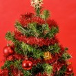 Stock Photo: Decorated christmas tree on red background