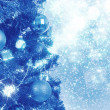 Blue christmas background with balls on tree — Stock Photo