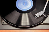 Vintage record player with spinning vinyl. Motion blur image. — Stock Photo