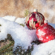 Stock Photo: Christmas balls on snowy day outdoor