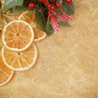Christmas background with needles and orange slices - Stock Photo