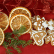 Christmas background with needles. orange slices and gingerbreads — Stock Photo