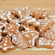 Christmas gingerbreads on wooden table — Stock Photo