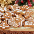 Christmas gingerbreads and decoration on wooden table — Stock Photo