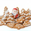 Christmas gingerbreads and ceramic santa on white background — Stock Photo