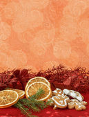 Orange slices and gingerbreads — Stock Photo