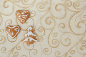 Homemade gingerbreads on christmas background — Stock Photo
