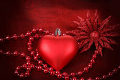 Valentine heart with flower on red background — Stock Photo
